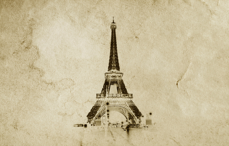 Old vintage paper texture background with the silhouette of the eiffel tower in Paris. High-quality photo texture of old vintage paper with scuffs, cracks and drops of spilled coffee. Foto de archivo