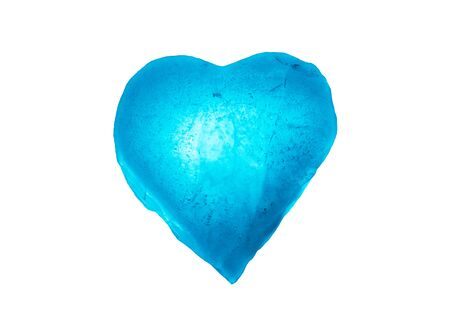 Ice frozen heart symbol of blue color close-up isolated on a white background. Texture of ice.