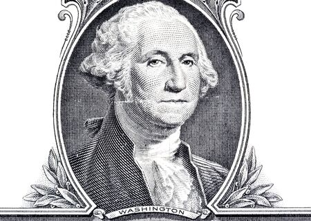 Portrait of George Washington on a US 1 dollar banknote macro close-up isolated on a white background