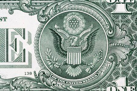 Primo piano macro dell'aquila su una banconota da 1 dollaro USA. Dettaglio di una banconota da un dollaro Archivio Fotografico