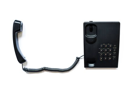 Simple modern push-button telephone of black color with a picked up handset isolated on a white background.
