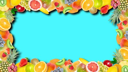 Creative photo of many different exotic tropical bright fruits frame with shadows on a summer blue background. View from above. Bright summer fruit pattern with copy space.