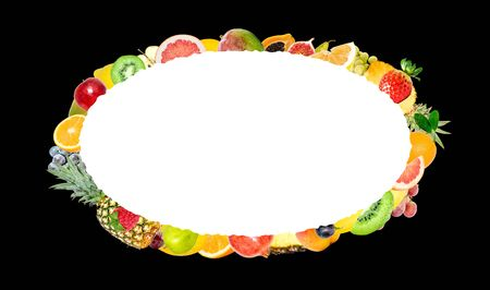 Creative photo of many different exotic tropical bright fruits isolated on a black background and an isolated oval with beautiful jagged edges in the center for text. Bright summer fruit pattern.