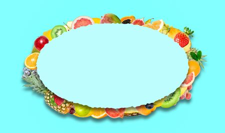 Creative photo of many different exotic tropical bright fruits with shadows on a blue background and an paper oval with beautiful jagged edges in the center for text. Bright summer fruit pattern.
