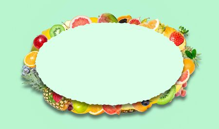 Creative photo of many different exotic tropical bright fruits with shadows on a minty green background and an paper oval with beautiful jagged edges in the center for text. Bright summer fruit pattern. Stockfoto