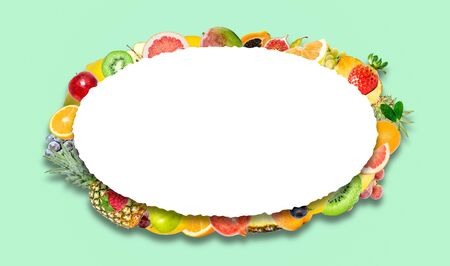 Creative photo of many different exotic tropical bright fruits with shadows on a green background and an isolated white oval with beautiful jagged edges in the center for text. Bright summer fruit pattern.