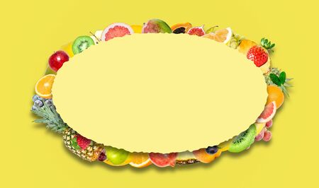Creative photo of many different exotic tropical bright fruits with shadows on a yellow background and an paper oval with beautiful jagged edges in the center for text. Bright summer fruit pattern.