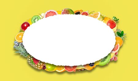 Creative photo of many different exotic tropical bright fruits with shadows on a yellow background and an isolated white oval with beautiful jagged edges in the center for text. Bright summer fruit pattern.