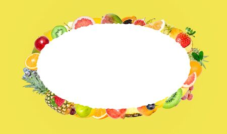 Creative photo of many different exotic tropical bright fruits on a yellow background and an isolated white oval with beautiful jagged edges in the center for text. Bright summer fruit pattern.