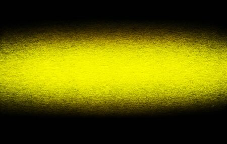 Good quality porous grunge yellow cardboard paper texture close-up with vignette dimming on the sides. Stockfoto