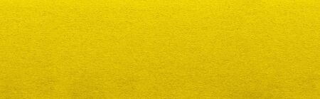 Good quality porous yellow cardboard paper texture close-up. Stockfoto