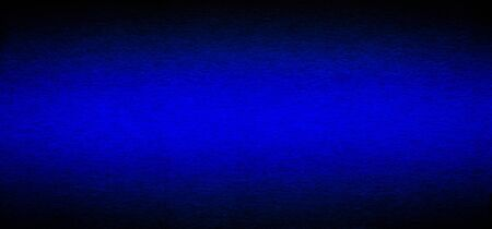 Good quality porous grunge dark blue color cardboard paper texture close-up with vignette dimming on the sides.
