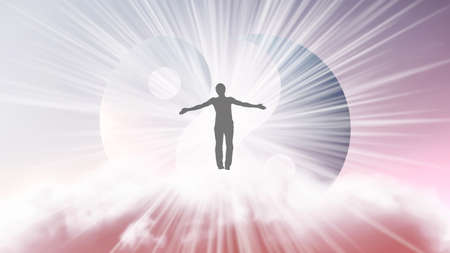 A silhouette of a man with arms spread apart, flying in the sky in a bright white sunlight on the background of the Yin-Yang symbol. Samadhi meditation concept, open mind. Stock Photo