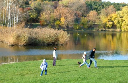 A family playing in the park photo