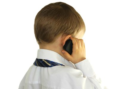 Little businessman talking on cell phone photo