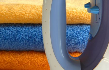 unmarried: iron and colourful towels, houseworks, metaphors