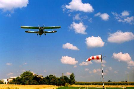 Airplane flying, biplane, windsock, sport, passion, leisure, travel, transportation, safety, mataphors