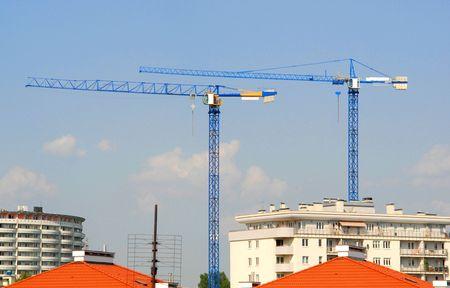 apartment shortage: Construction industry, building, cranes, industries, urban development, concept Stock Photo
