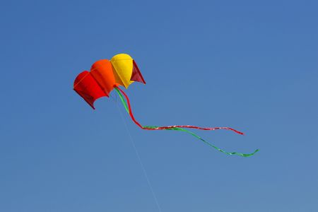 Flying kite on the blue sky Stock Photo - 1354371