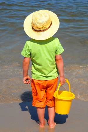 Boy at the seaside, summer holidays, concept photo