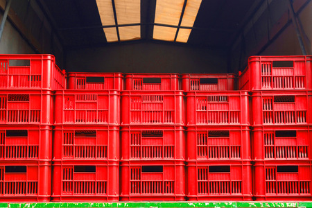 Red delivery boxes in the truck Stock Photo