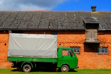 Green truck at the farmyard