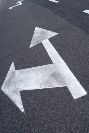 informational: Street arrow painted on the street Stock Photo