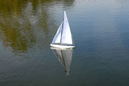 Little sailboat on the water