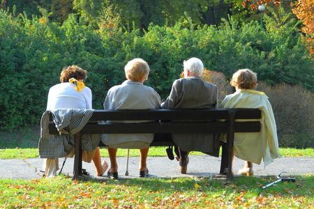 active seniors: Seniors relaxing in the autumn park Stock Photo