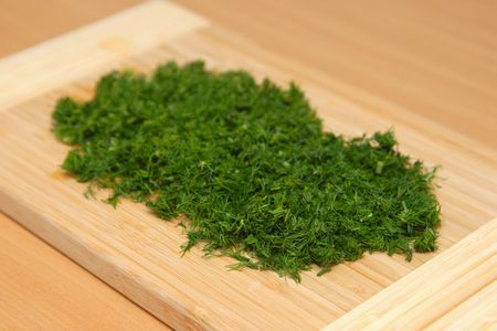 A cutting dill on the chopping board photo