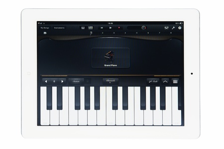Apple iPad 2 with GarageBand music software isolated on white studio shot