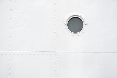 Marine background with brass porthole  photo