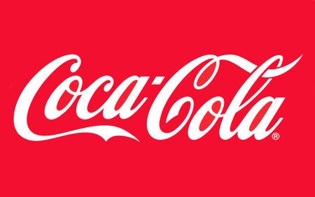 Een close up van de Coca-Cola logo op de rode achtergrond
