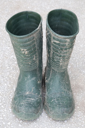 muddy clothes: Dirty rubber boots