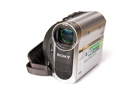 hand held: Sony DCR-HC51 Digital Handycam 800 Kpix - optical zoom: 40 x - Mini DV isolated on the white background Editorial