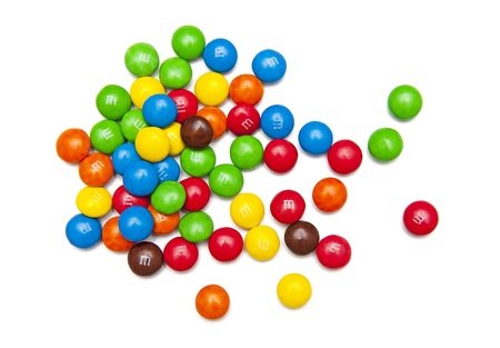hersheys: M&M colorful button-shaped candies isolated on the white background