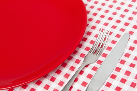 Red plate and cutlery photo