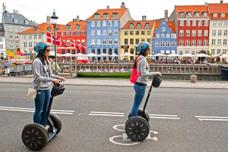 COPENHAGEN, DENMARK - JULY 2  Tourists riding segways in Nyhavn on July 2, 2014 in Copenhagen