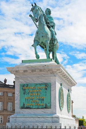 frederik: COPENHAGEN, DENMARK - JULY 2  Equestrian Statue of King Frederik V in Amalienborg Square on July 2, 2014 in Copenhagen