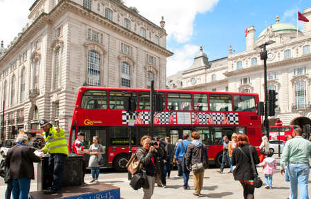 piccadilly: LONDON, ENGLAND - MAY 30: Double-decker bus at the Piccadilly Circus on May 30, 2015 in London Editorial