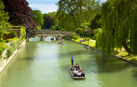 28: CAMBRIDGE, ENGLAND - MAY 28: Trinity College, University of Cambridge. Punting on the River Cam on May 28, 2015 in Cambridge Editorial