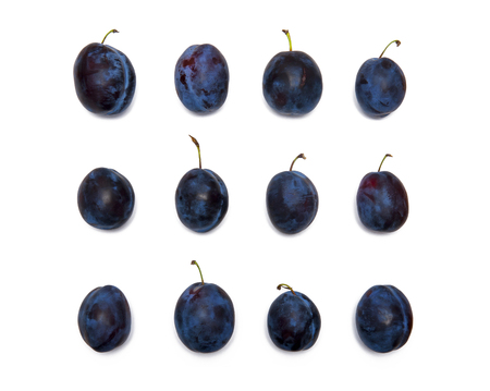 Twelve plums isolated on white background