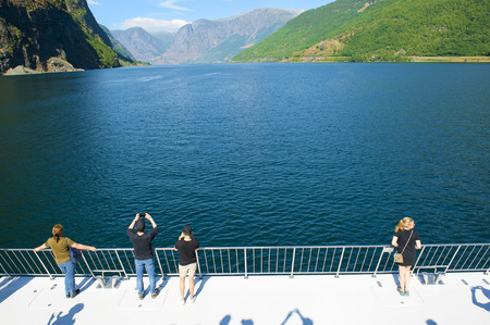 FLAM - GUDVANGEN CRUISE, NORWAY - JULY 16, 2018: Breathtaking Norwegian fjord and mountain landscapes on Norway in a Nutshell Tour. The Aurlandsfjord and Naeroyfjord - UNESCO protected fjord - cruise. The Aurlandsfjord landscape. Editorial