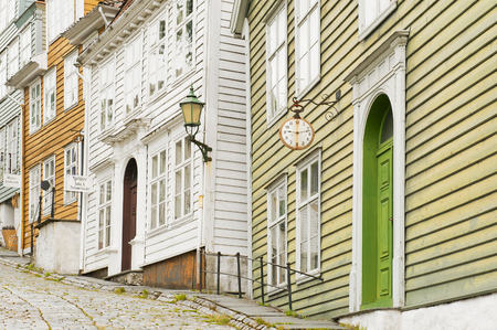 BERGEN, NORWAY - JULY 21, 2018: Watchmaker`s House, Painting Workshops and Cosmetics Store in Gamle Old Bergen Museum - The Open Air Museum. 18th and 19th centuries. Editorial