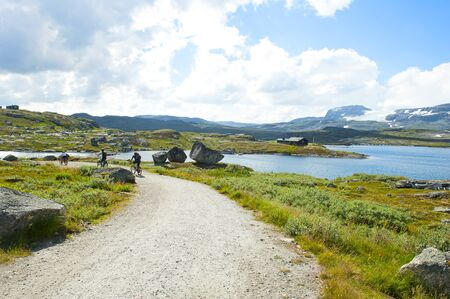 Tourists biking and beautiful landscape in Finse, Norway, on July 28 2019