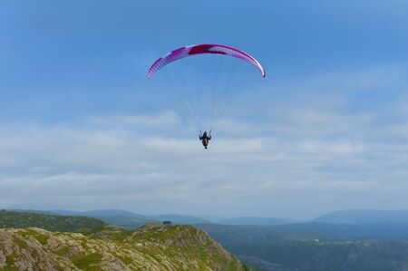 Beautiful landscape with paraglider seen from the Mount Ulriken in Bergen, Norway, on August 4 2019 Фото со стока