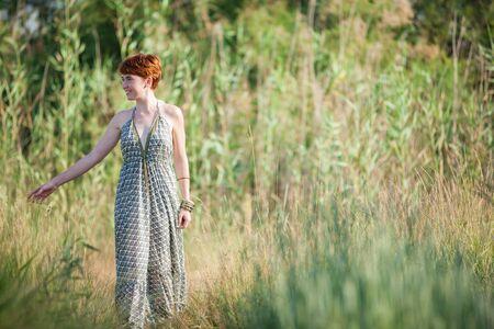 FREEDOM, RADIOUS WOMAN WALKING OUTSIDE 版權商用圖片