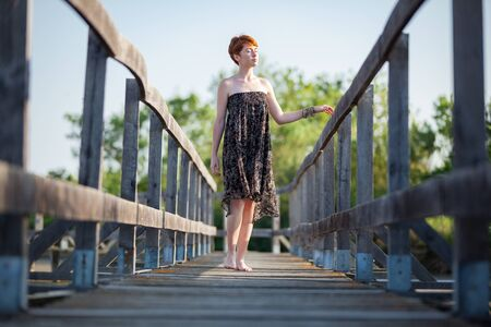 WOMAN FLANKING ON A GATEWAY