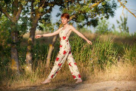 WOMAN WALKING IN THE COUNTRYSIDE 版權商用圖片