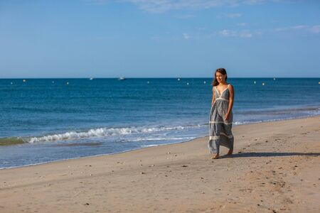 Young woman walking foots on the sand of the beach. Joy and freedom concept. Stock Photo